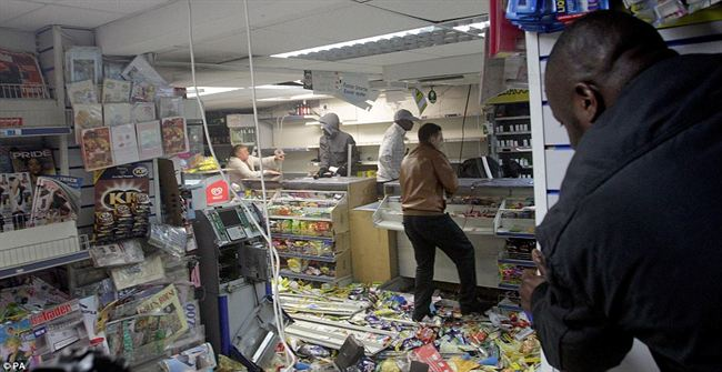 Rampagegroup looters raid local shop Hackney  stripping the shelves bare drink and cigarettes  while cash machine also ripped apart
