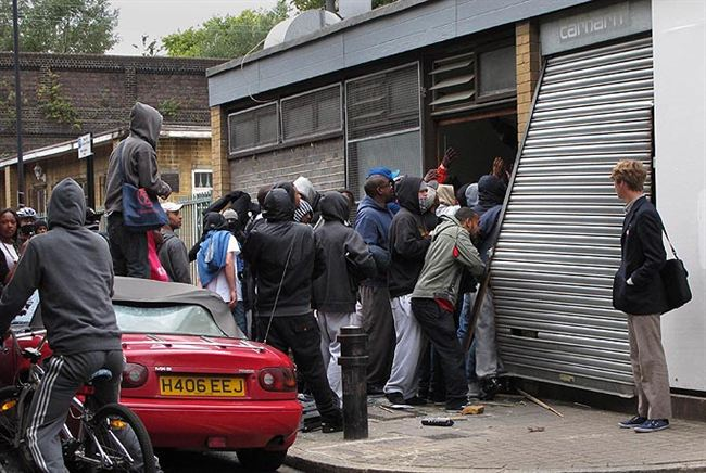 Smashed   hooded looters storm shop Hackney